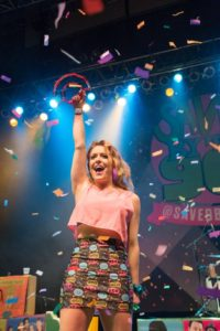 Emily performing with her 90s cover band, Saved by the 90s.